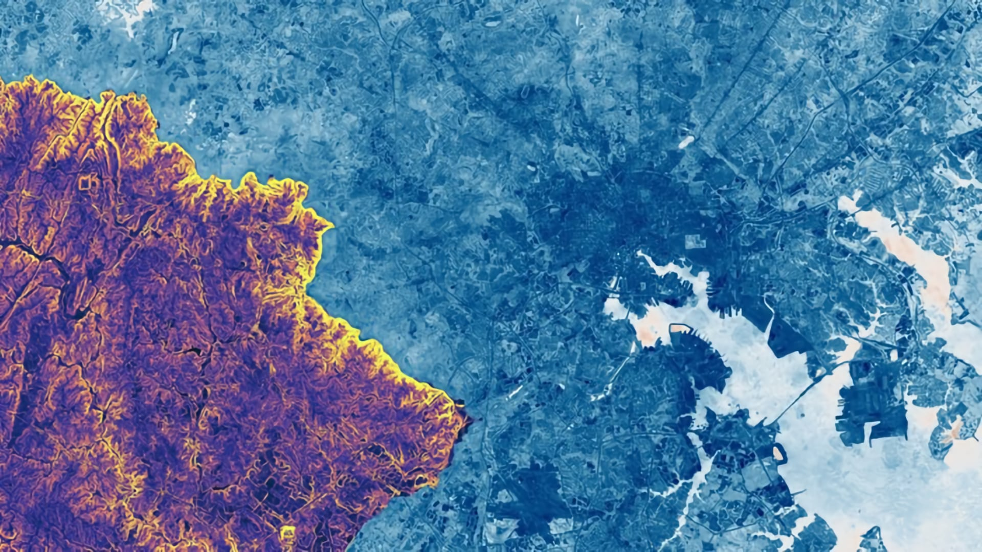 NDWI Composite from Landsat 8 tier 1 (2019) is shown with surface slope, derived from a statewide DEM of Maryland (2011), clipped to the border of Howard County, overlaid. The greater Baltimore area is shown; the merge of the Patapsco River and the Chesapeake Bay is seen lower right. Lighter shades of blue indicate higher surface and plant water content. In regards to the DEM, yellow shows a high degree of slope, while purple shows low slope. The convergence points of several watersheds along the Patapsco river (bright yellow border) can be identified, including the Tiber-Hudson watershed at Ellicott City. High NDWI values and steep slopes indicate areas in danger of flooding due to runoff.
